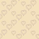 Corazones abstractos en un fondo beige Foto de archivo libre de regalías