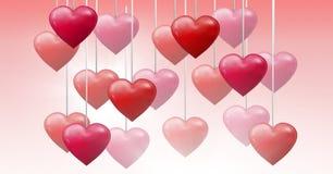 Corazones burbujeantes de las tarjetas del día de San Valentín que cuelgan en secuencia Imagen de archivo libre de regalías