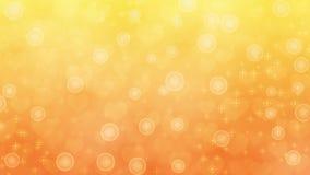 Corazones, chispas y burbujas borrosos abstractos en fondo amarillo y anaranjado imagen de archivo libre de regalías