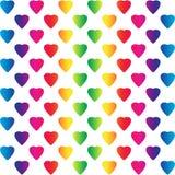 Corazones coloreados arco iris brillante en blanco Fotografía de archivo libre de regalías