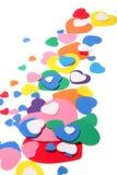 Corazones coloridos del confeti de la espuma Fotos de archivo libres de regalías