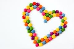 Corazones coloridos hechos de los dulces Fotografía de archivo