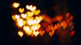 Corazones de Bokeh que centellan - simbol del amor almacen de metraje de vídeo