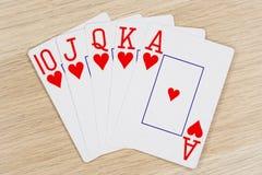 Corazones de la escalera real - casino que juega tarjetas del póker fotografía de archivo libre de regalías