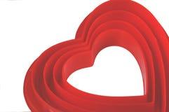 Corazones de la tarjeta del día de San Valentín 4 que jerarquizan dentro de uno a Imagen de archivo libre de regalías