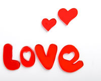 Corazones de la tarjeta del día de San Valentín con Amor-palabra Fotos de archivo libres de regalías