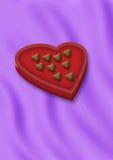 Corazones de los chocolates en caja Foto de archivo libre de regalías