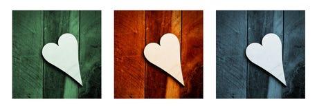 Corazones de madera en el fondo de madera, tríptico Imagenes de archivo