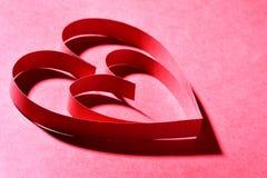Corazones de papel rojos Imágenes de archivo libres de regalías