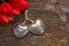 Corazones del amor con las flores Imagenes de archivo