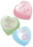 Corazones del caramelo con los mensajes de la desintegración Fotos de archivo