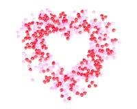 Corazones del caramelo en la forma de un corazón Imagen de archivo