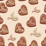 Corazones del chocolate con el amor de la inscripción Caramelos Foto de archivo libre de regalías