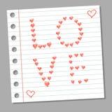 Corazones del garabato en la página del cuaderno Imágenes de archivo libres de regalías