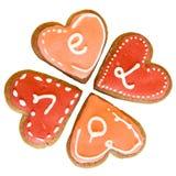 4 corazones del pan de jengibre con el subtítulo del ` del amor del ` imágenes de archivo libres de regalías