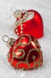 Corazones del rojo de las decoraciones de la Navidad Imagen de archivo libre de regalías