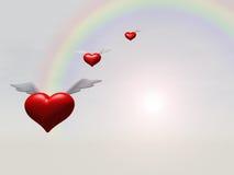 Corazones del vuelo sobre el arco iris Imágenes de archivo libres de regalías