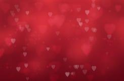 Corazones en un fondo rojo Imágenes de archivo libres de regalías