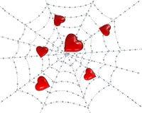 Corazones en un Web con rocío imagen de archivo libre de regalías