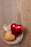 3 corazones en una cesta Imágenes de archivo libres de regalías