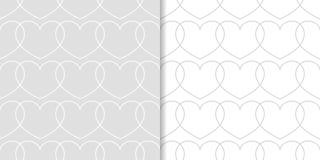 Corazones grises y blancos como modelos inconsútiles Sistema de fondos románticos Imagenes de archivo
