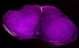Corazones que brillan intensamente púrpuras Foto de archivo libre de regalías