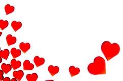 Corazones rojos brillantes en dos corazones grandes en la esquina derecha Para utilizar día del ` s de la tarjeta del día de San  Imagen de archivo libre de regalías
