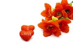 Corazones rojos con la flor roja Fotografía de archivo