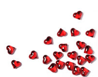 Corazones rojos en un fondo blanco con las sombras, fondo del concepto de las tarjetas del día de San Valentín Fotografía de archivo libre de regalías