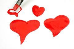 Corazones rojos pintados Foto de archivo libre de regalías