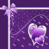 Corazones y arqueamiento púrpuras del amor. Foto de archivo libre de regalías