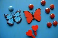 Corazones y piedras rojos del arte de las mariposas Fotografía de archivo libre de regalías