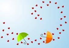 Corazones y tarjeta ventosos del día de tarjetas del día de San Valentín de los paraguas Foto de archivo libre de regalías