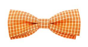 Corbata de lazo anaranjada con las rayas blancas imagen de archivo