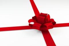 Corbata de lazo roja en un arco aislado en el fondo blanco Imágenes de archivo libres de regalías
