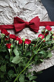corbata de lazo y una rosa Imagenes de archivo
