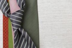 Corbata del color en fondo de la lona Imagen de archivo libre de regalías