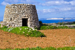 Corbelled stone hut Stock Images