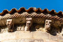 Corbels in the cornice of the apse of a Romanesque church. Close up of decorated corbels in the cornice of the apse of a Romanesque church of Villanueva de stock image
