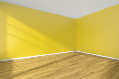 Corber of yellow empty room with wooden parquet floor. Corner of empty room with yellow walls, hardwood parquet floor and sunlight from window on the wall Stock Images