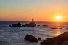 Corbière Lighthouse. At sunset, Jersey, Channel Islands Royalty Free Stock Photos