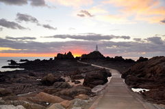Corbiere lighthouse in Jersey Stock Images