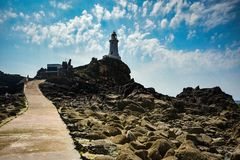 Corbiere Lighthouse on a sunny day. Jersey, Channel Islands stock photos