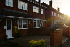 Corby, England. November 13 - Brick village traditional houses at sunset. stock photos