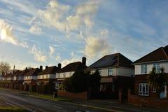 Corby, England. November 13 - Brick village traditional houses at sunset. royalty free stock photo