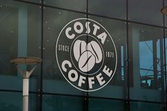 Corby, U.K, april 28, 2019 - Costa sign, logo on window display coffee shop royalty free stock photo
