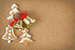 Corcboard with ginger bread and christmas bells Royalty Free Stock Images