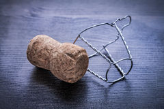 Corck of champagne and wire on wood board Stock Image