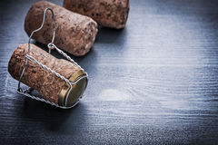 Corcks di vista tre di Copyspace di champagne con i cavi Immagine Stock