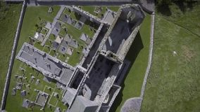 Corcomroe Abbey is an early 13th-century Cistercian monastery located in the north of the Burren region of County Clare, Ireland. stock video